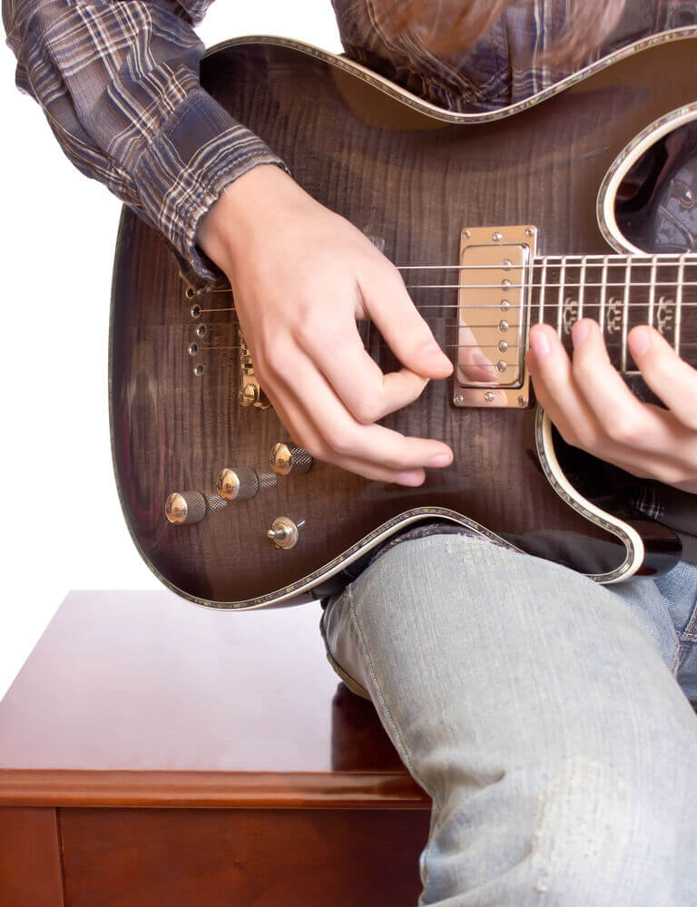 A guitarist playing his guitar