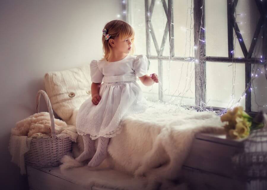 Adorable little girl in white dress