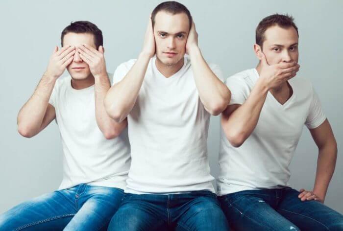 Closeup portrait of three young men