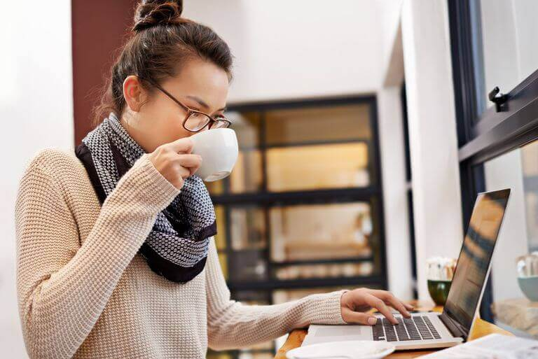 Blogger working while having a cup of coffee