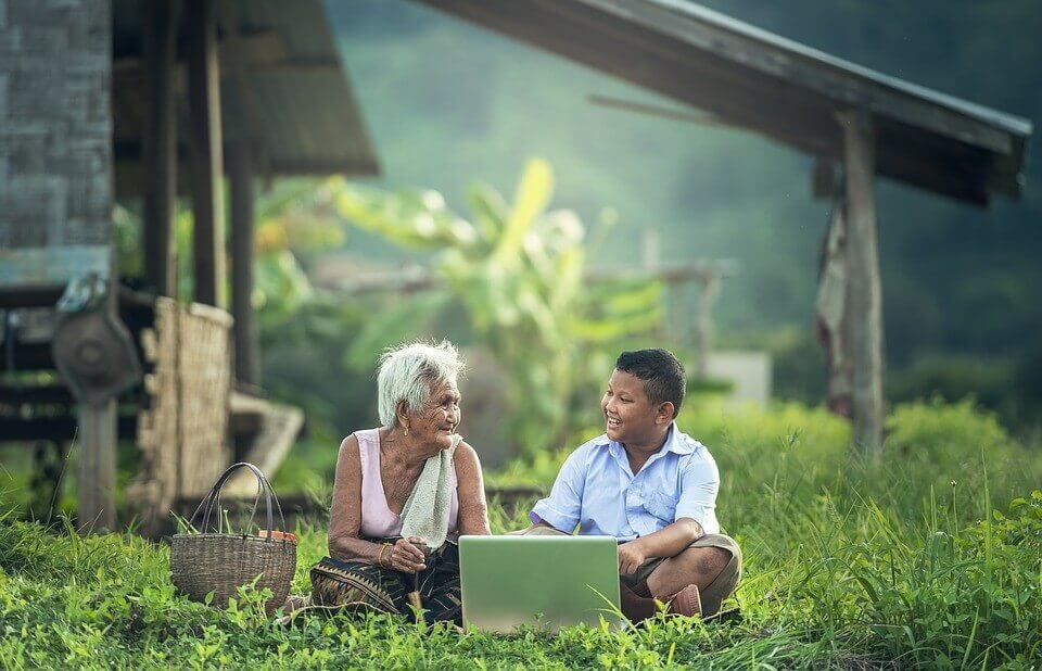 Grandmother and kid using a laptop