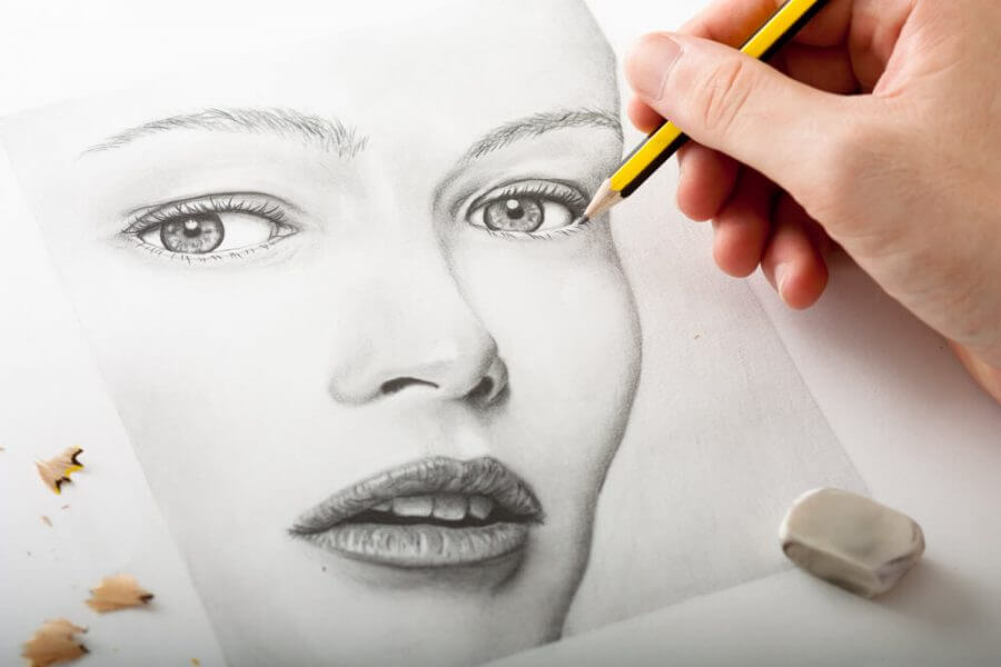 Hand Drawing a Woman Face with Pencil