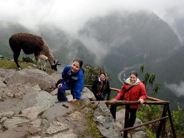 American family in the rain on Inca Trail several kilometers from Machu Picchu