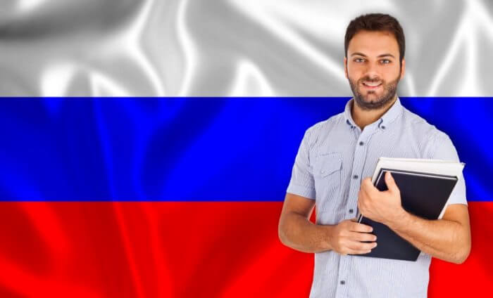 Male student of languages Russian flag
