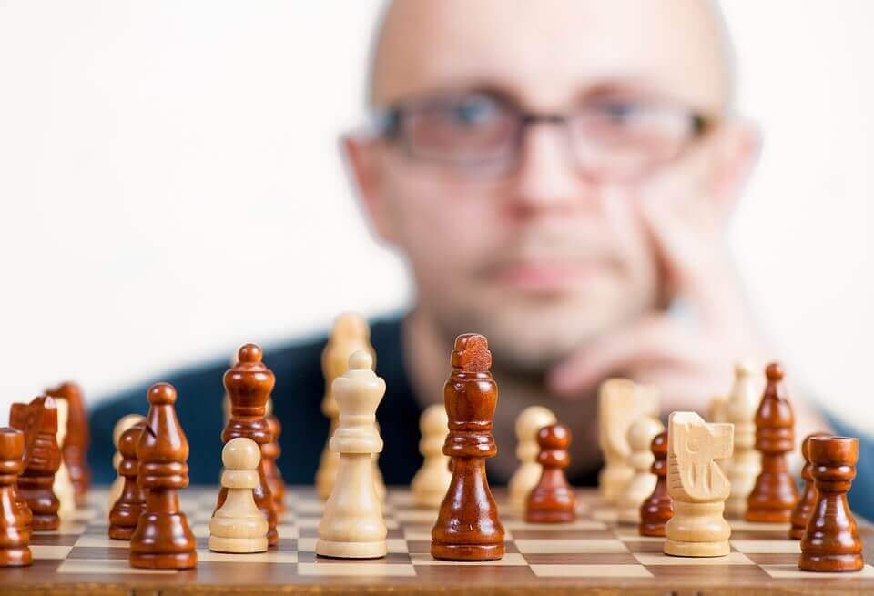 Man in front of a chess board