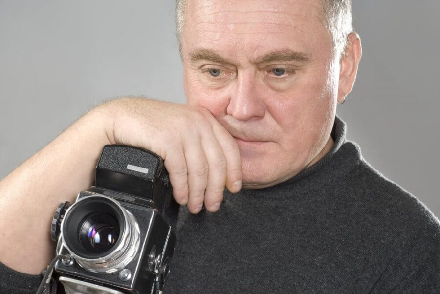 Middle aged man with camera