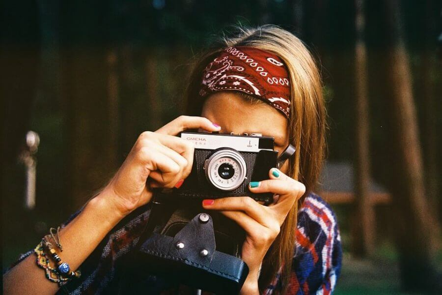 woman taking photograph