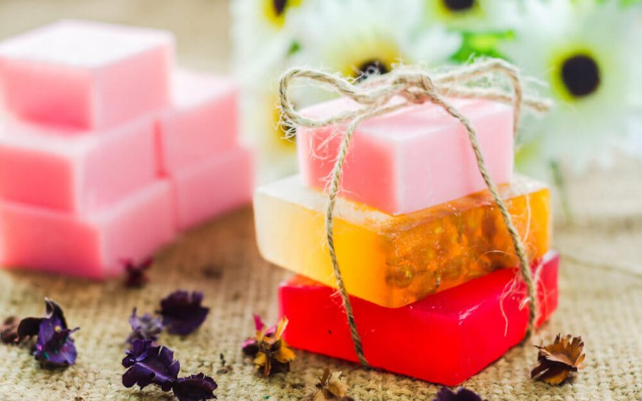 Spa setting with natural soaps and flower