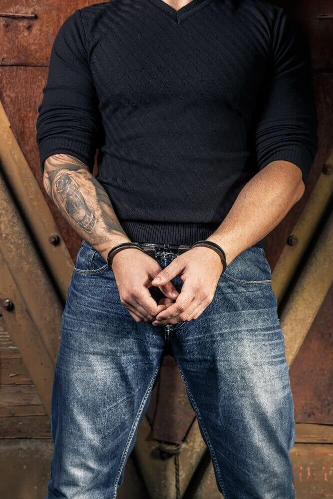 Tattooed hands of a criminal