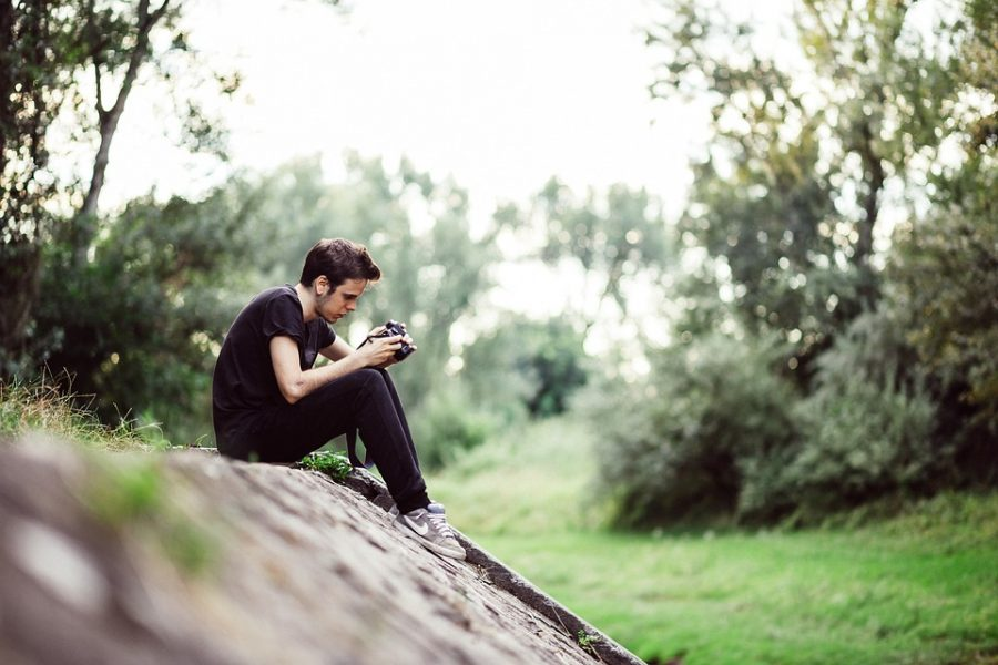 Young Camera Photographer Professional Sitting