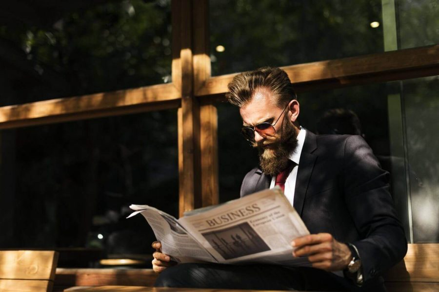 businessman reading newspapers