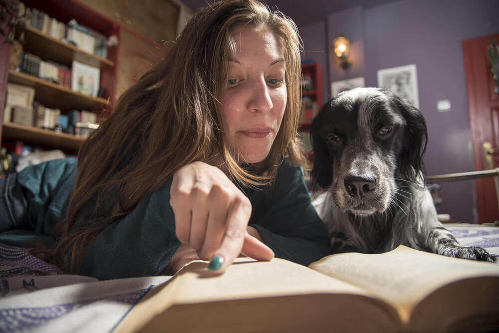 reading a book with her dog