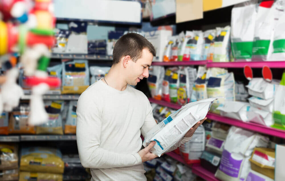 european guy selecting vet food in petshop