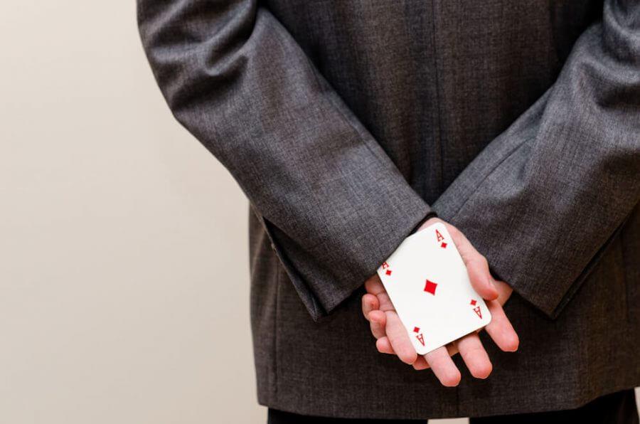 holding an ace card