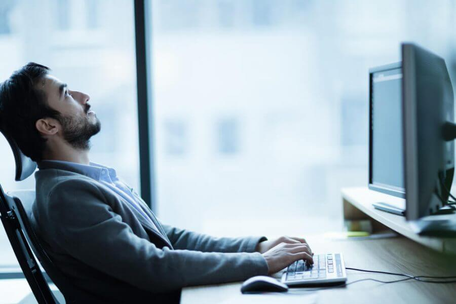 man at workplace in office being unhappy