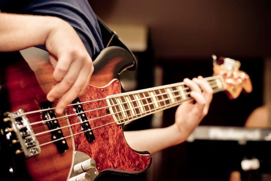 musician playing a bass guitar