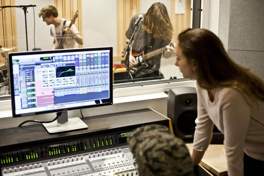 people in a music studio
