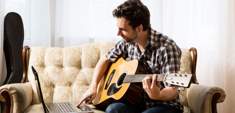 practicing guitar from guitar notes master