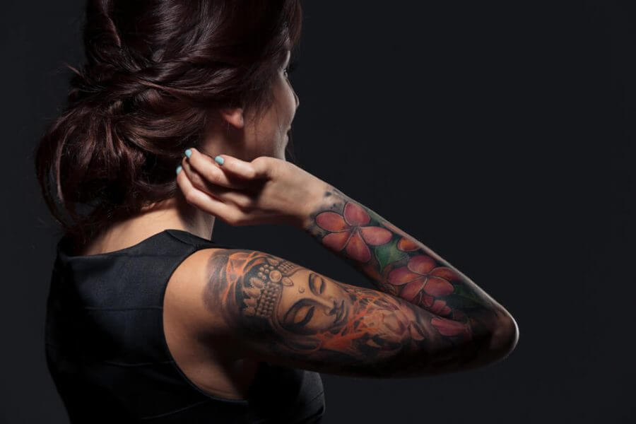 woman with tattooed hand