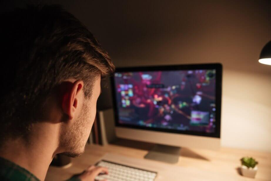 young man playing computer games